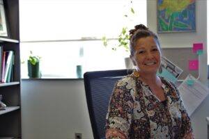 Kristina Henry, the experiential Learning Coordinator sitting in office